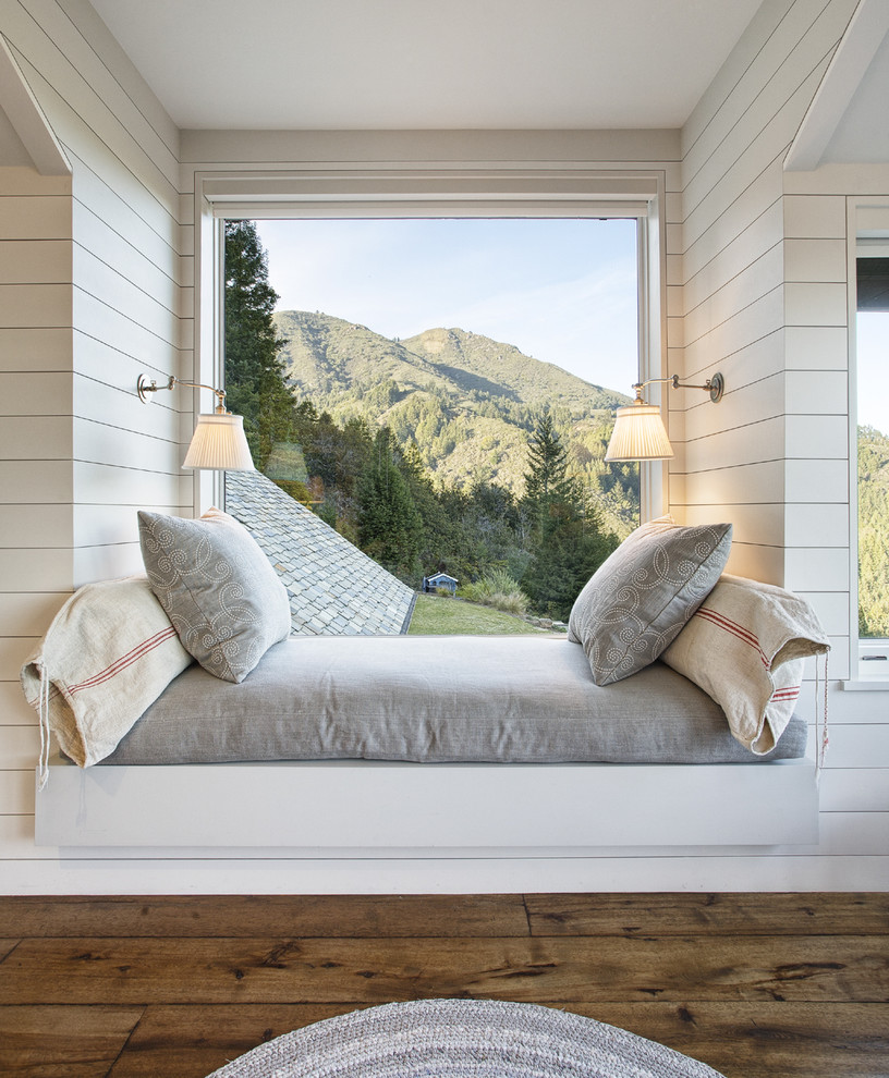 Bedroom - small rustic guest dark wood floor bedroom idea in San Francisco with white walls and no fireplace