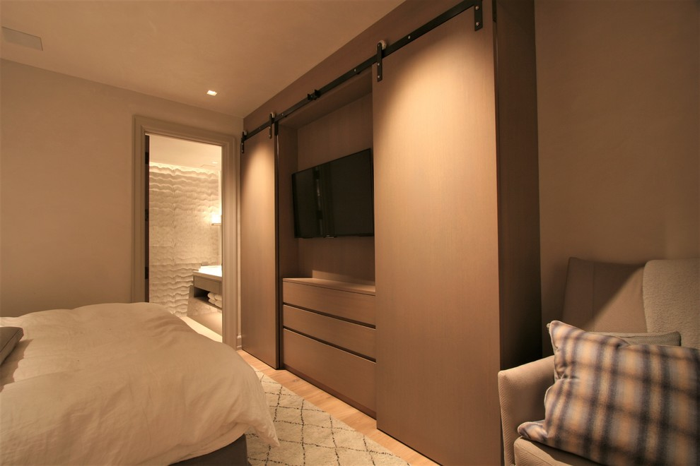 Bedroom - mid-sized modern master light wood floor bedroom idea in Denver with no fireplace and beige walls