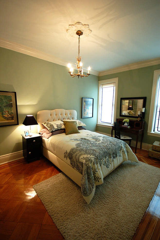 Example of a classic guest dark wood floor bedroom design in Other with green walls