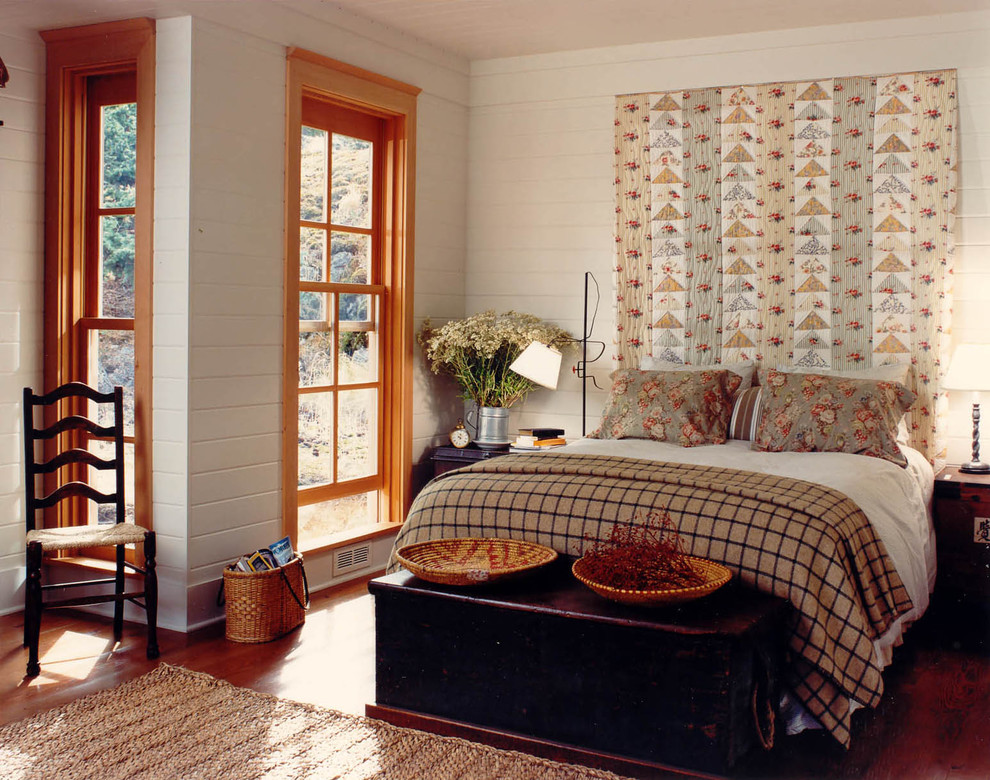 Inspiration for a rustic medium tone wood floor bedroom remodel in Seattle with beige walls