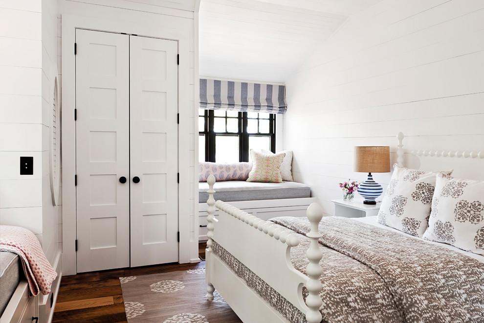 Bedroom - coastal master medium tone wood floor and orange floor bedroom idea in Toronto with white walls