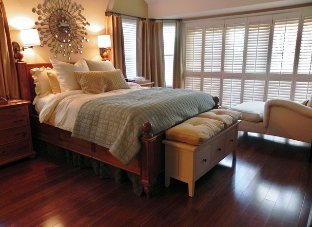 muted colors, plantation shutters, mounted bedside lamps, relaxed, cozy traditional-bedroom