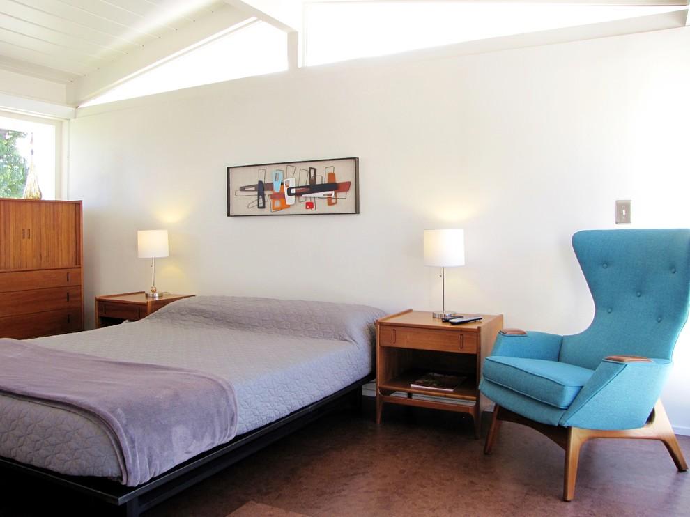 Example of a 1950s cork floor bedroom design in Orange County with white walls