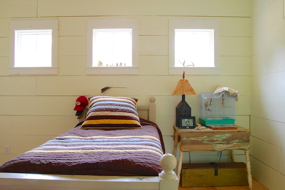 Inspiration for a shabby-chic style bedroom remodel in New York with white walls