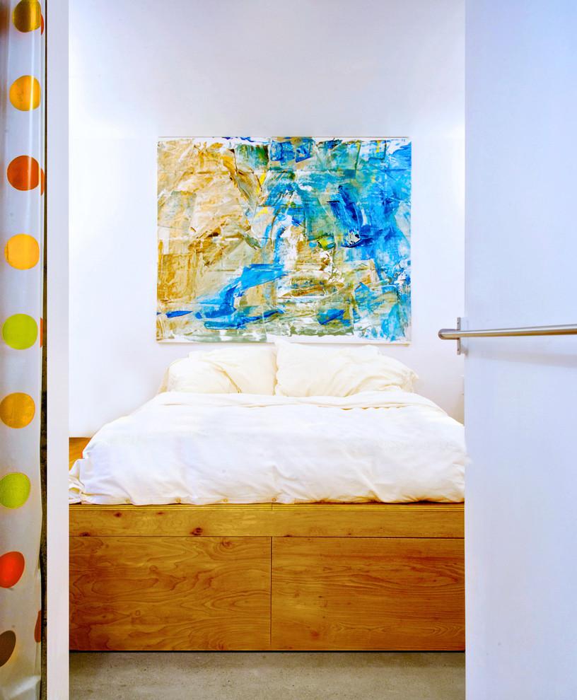 Trendy concrete floor bedroom photo in Toronto with white walls