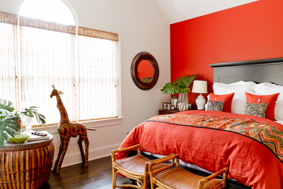 Example of a classic bedroom design in New York with red walls