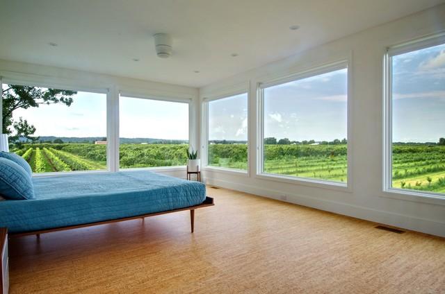 Bedroom - contemporary cork floor bedroom idea in Toronto with white walls