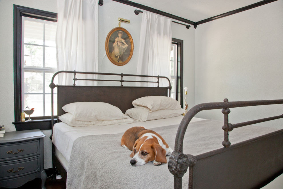 Inspiration for a victorian bedroom remodel in Austin with white walls and no fireplace