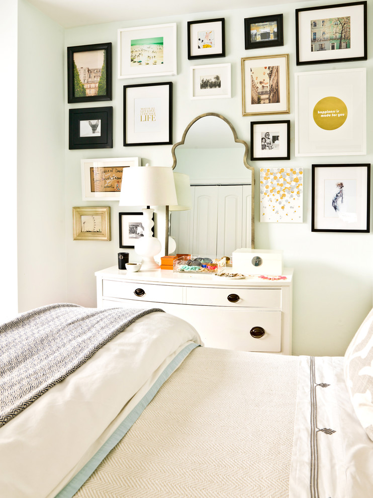 Inspiration for an eclectic bedroom remodel in Chicago with white walls
