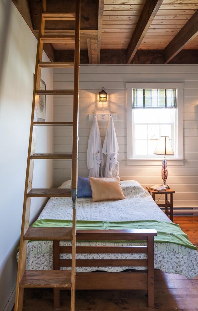 Bedroom - coastal medium tone wood floor and orange floor bedroom idea in Other with white walls