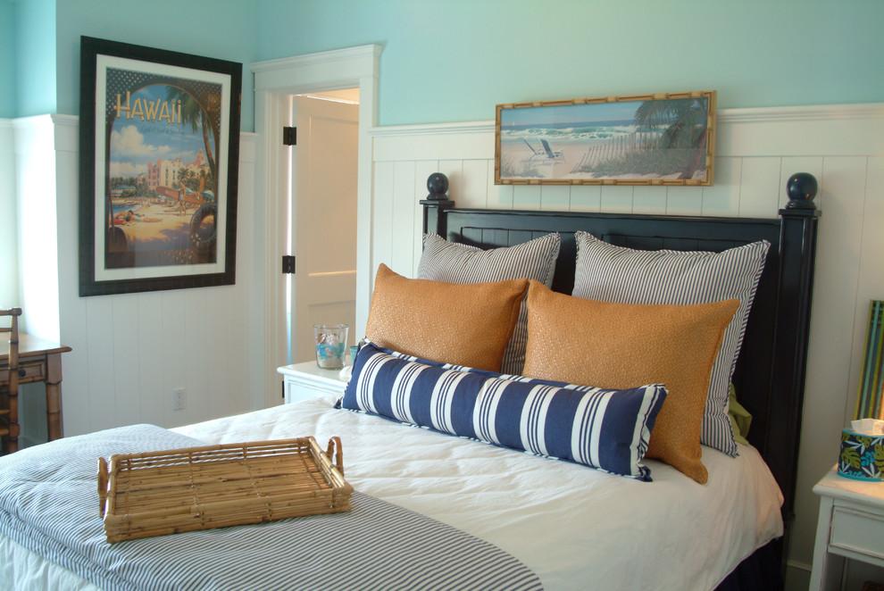 Example of a coastal bedroom design in Los Angeles with blue walls