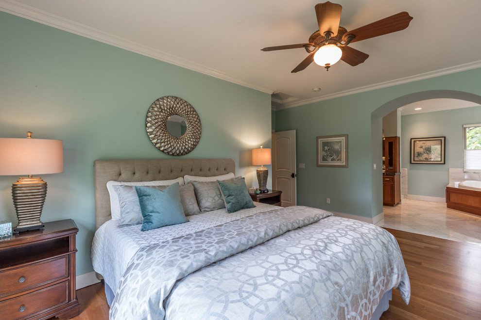 Inspiration for a timeless master medium tone wood floor and brown floor bedroom remodel in Sacramento with blue walls