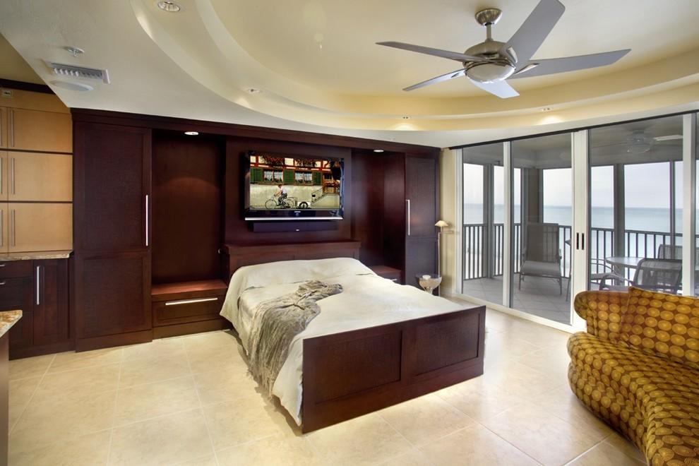 Trendy travertine floor bedroom photo in Miami with beige walls