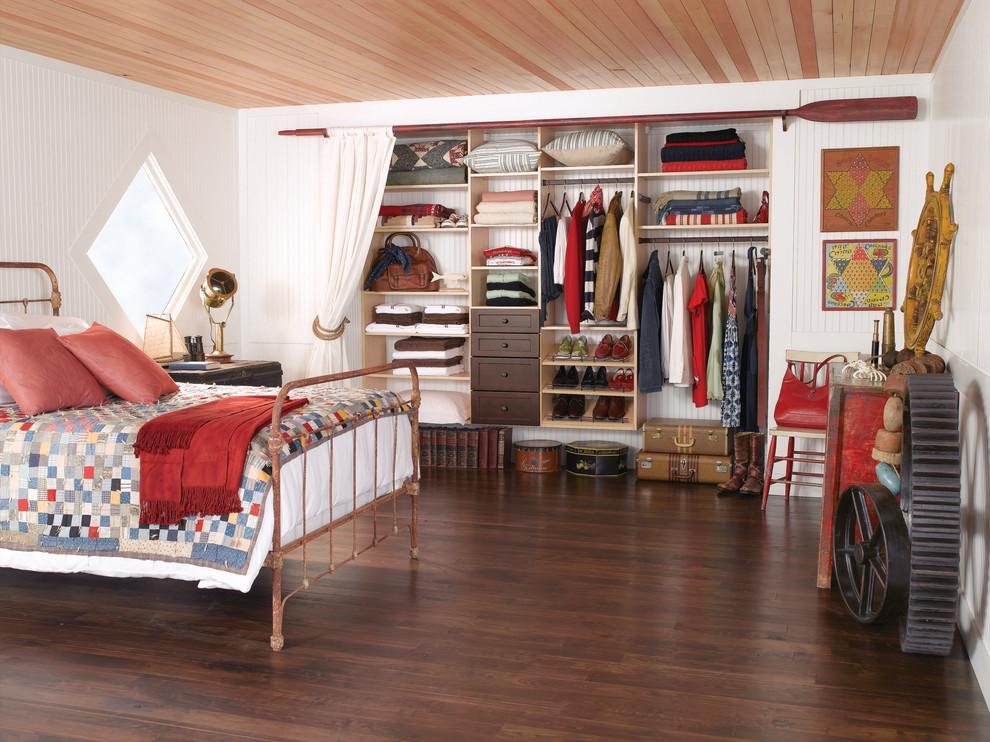 Example of a large minimalist dark wood floor and brown floor bedroom design in Orlando