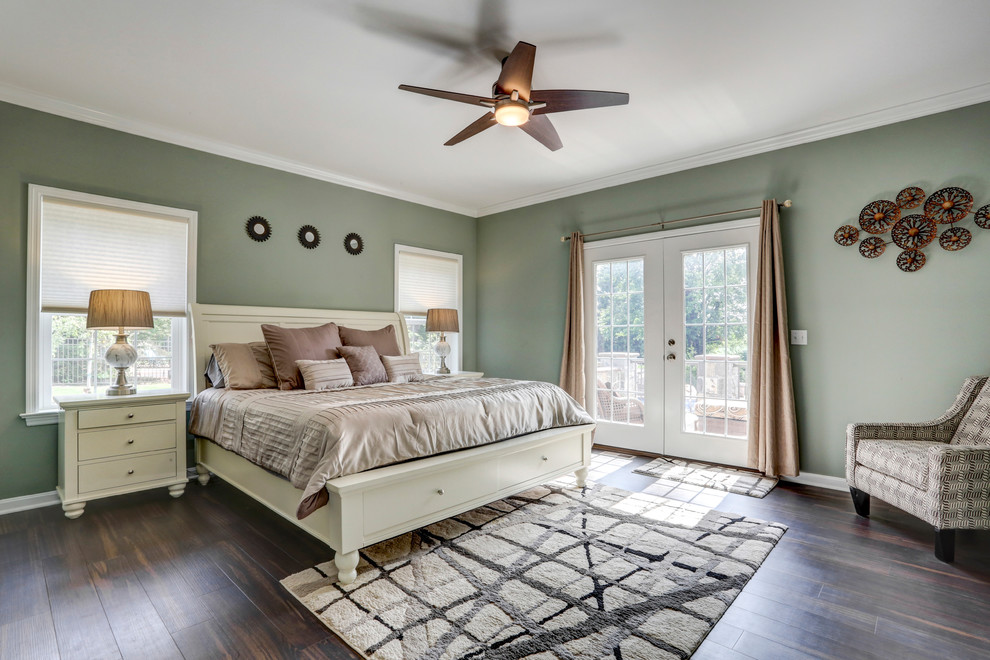 Example of a classic master dark wood floor and brown floor bedroom design in Other with green walls