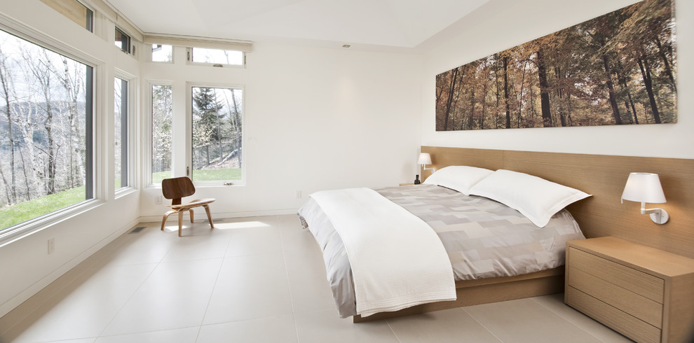 Large trendy master porcelain floor and beige floor bedroom photo in Ottawa with white walls