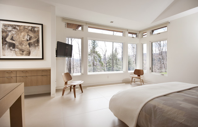 large contemporary master ceramic floor and beige floor bedroom idea in ottawa with white walls