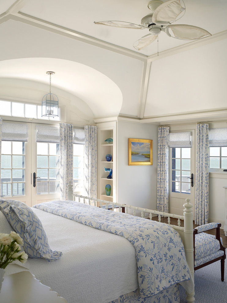 Bedroom - coastal bedroom idea in New York with white walls