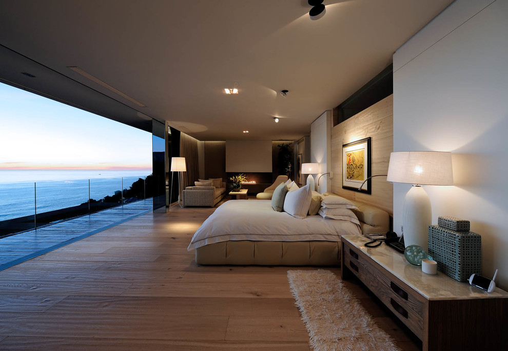 Inspiration for a contemporary bedroom remodel in Other with white walls