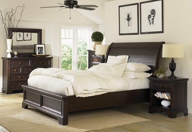 Neutral Bedroom With Dark Wood Furniture Traditional