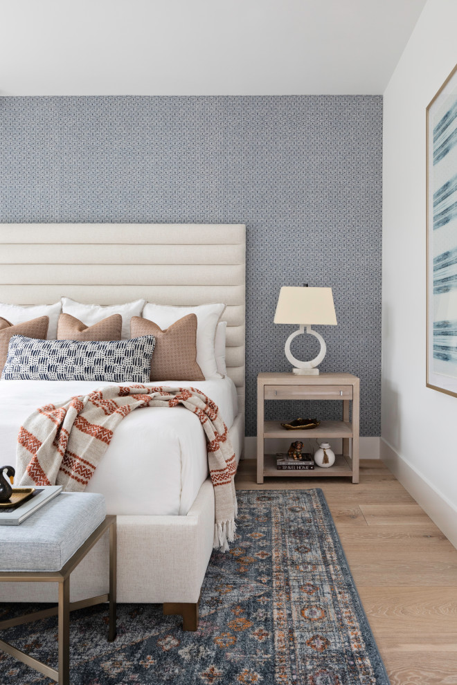 Inspiration for a large transitional guest light wood floor, wallpaper and beige floor bedroom remodel in Orlando with blue walls