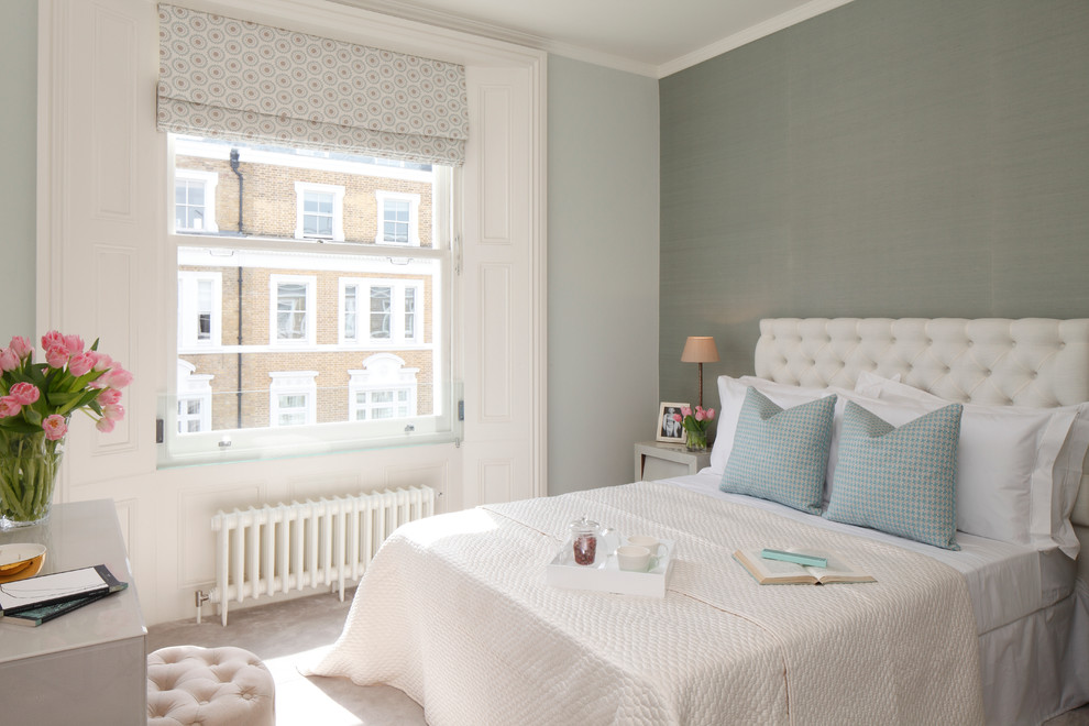 Inspiration for a transitional master carpeted bedroom remodel in London with gray walls