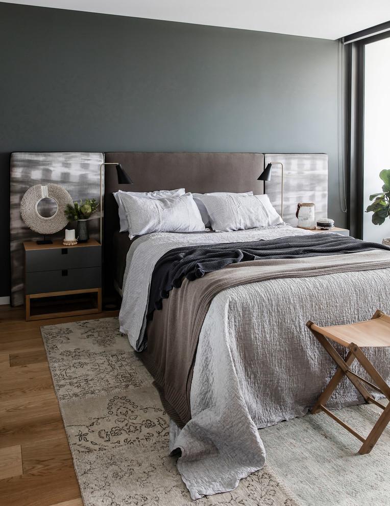 Bedroom - coastal master medium tone wood floor and brown floor bedroom idea in Other with gray walls