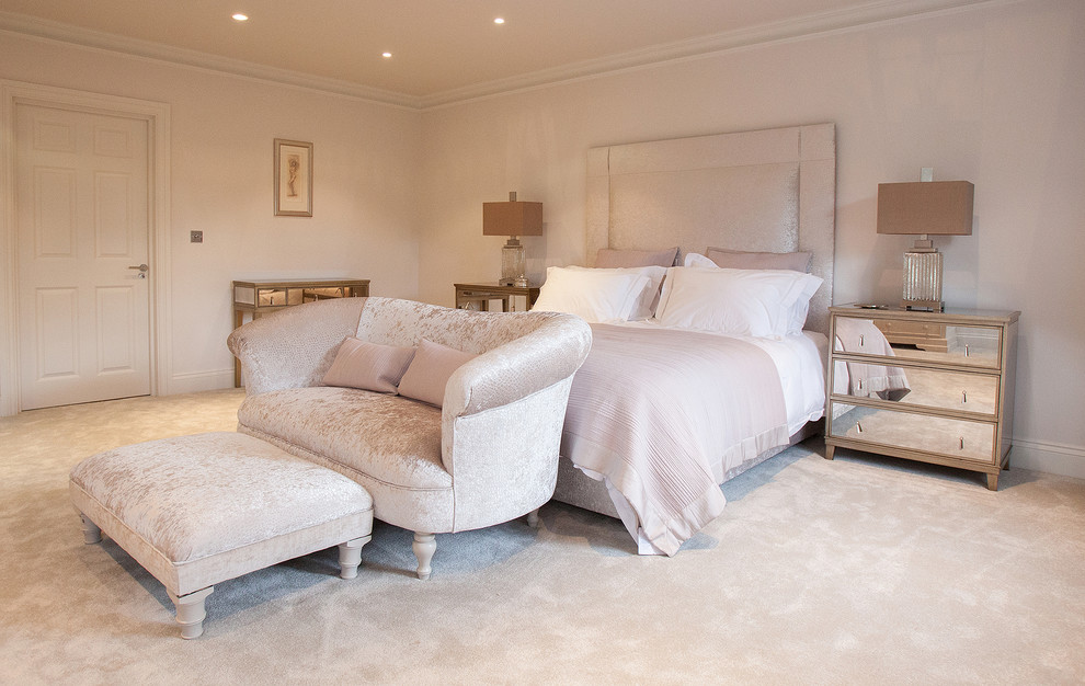 Inspiration for a transitional master carpeted bedroom remodel in Surrey with beige walls