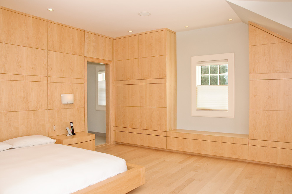 Minimalist light wood floor bedroom photo in Portland Maine with white walls and no fireplace