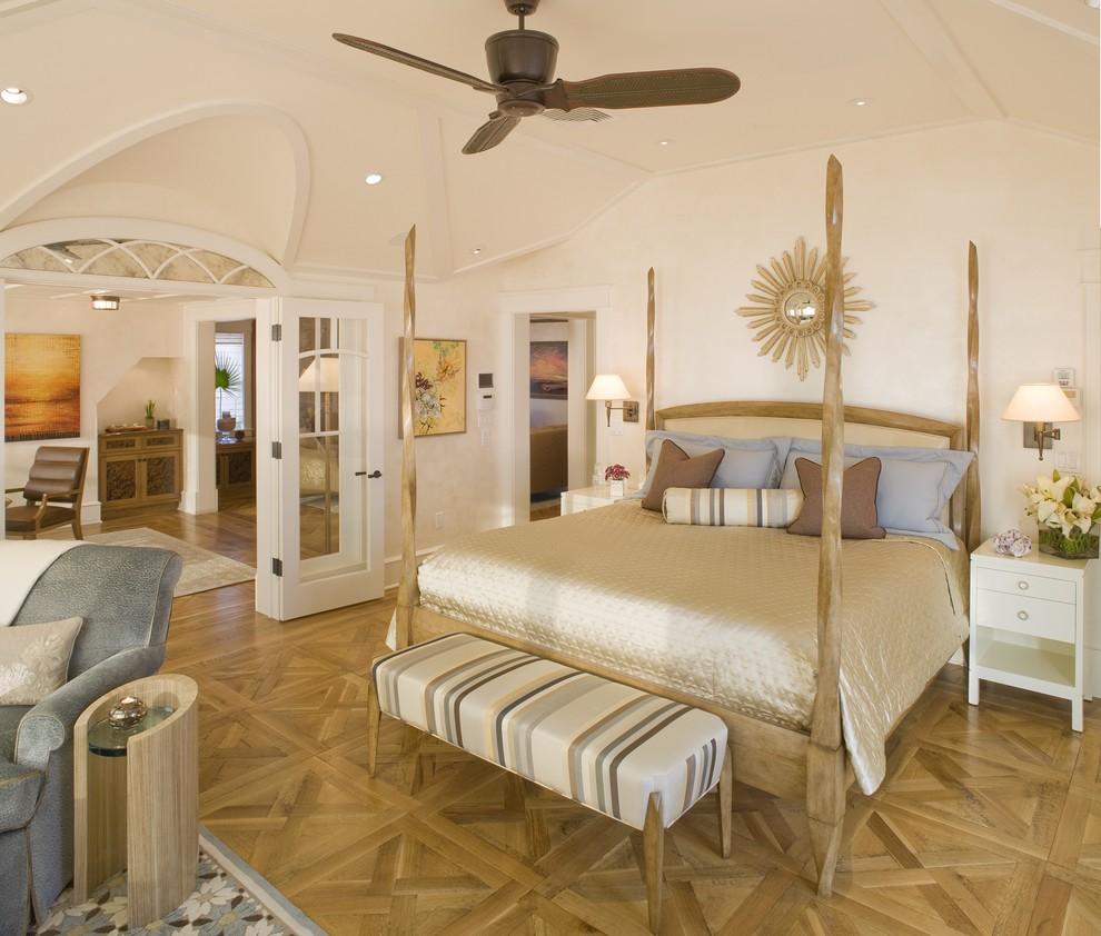 Trendy medium tone wood floor and brown floor bedroom photo in Philadelphia with beige walls