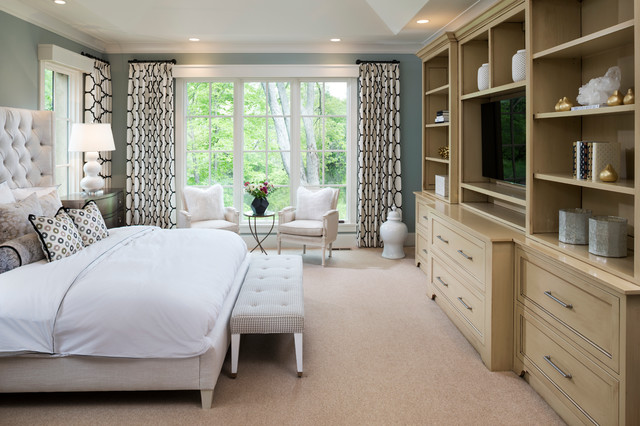 midsized traditional master carpeted and beige floor bedroom idea in minneapolis with blue walls