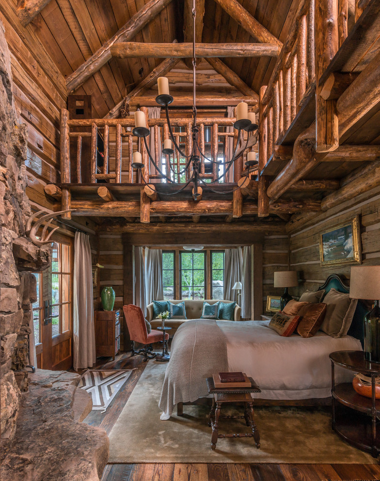 Inspiration for a rustic master medium tone wood floor bedroom remodel in Philadelphia with a standard fireplace and a stone fireplace