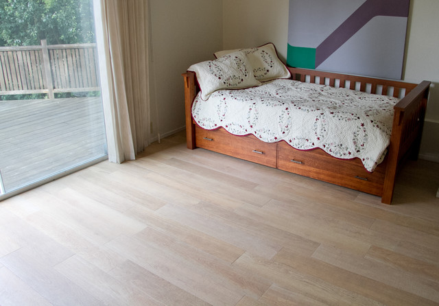 New tile floors for guest room porcelain tile hardwood for Hardwood floors in bedrooms