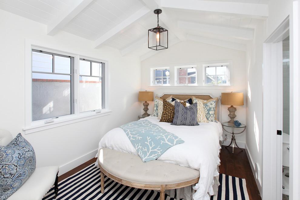 Bedroom - traditional dark wood floor bedroom idea in Orange County with white walls