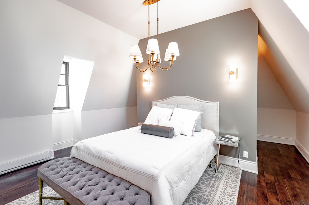 Example of a transitional bedroom design in Toronto