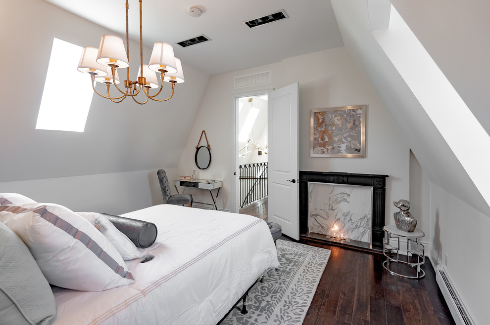 Example of a transitional guest dark wood floor bedroom design in Toronto with white walls and a standard fireplace