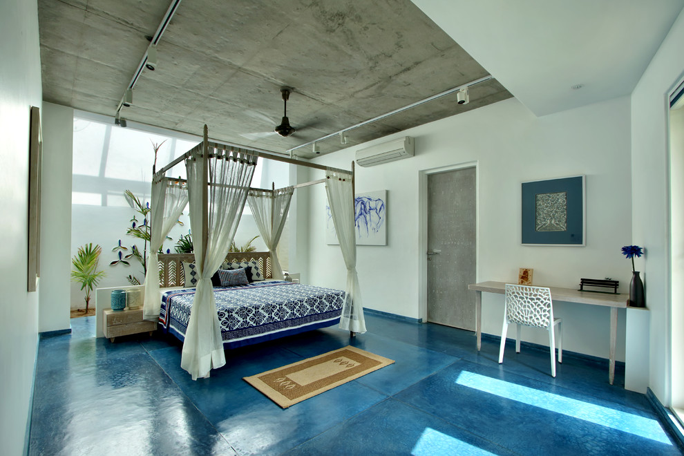 Bedroom - tropical blue floor bedroom idea in Ahmedabad with white walls