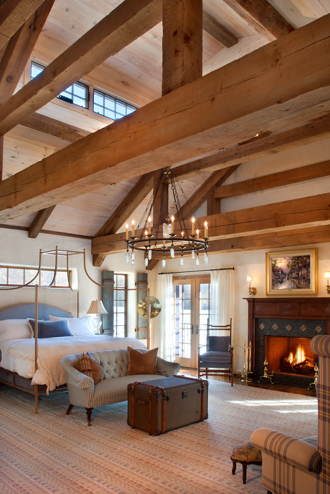Bedroom - large farmhouse master carpeted bedroom idea in Philadelphia with beige walls, a standard fireplace and a wood fireplace surround