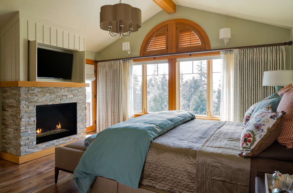 Bedroom - mid-sized eclectic master medium tone wood floor bedroom idea in Portland with blue walls, a standard fireplace and a stone fireplace