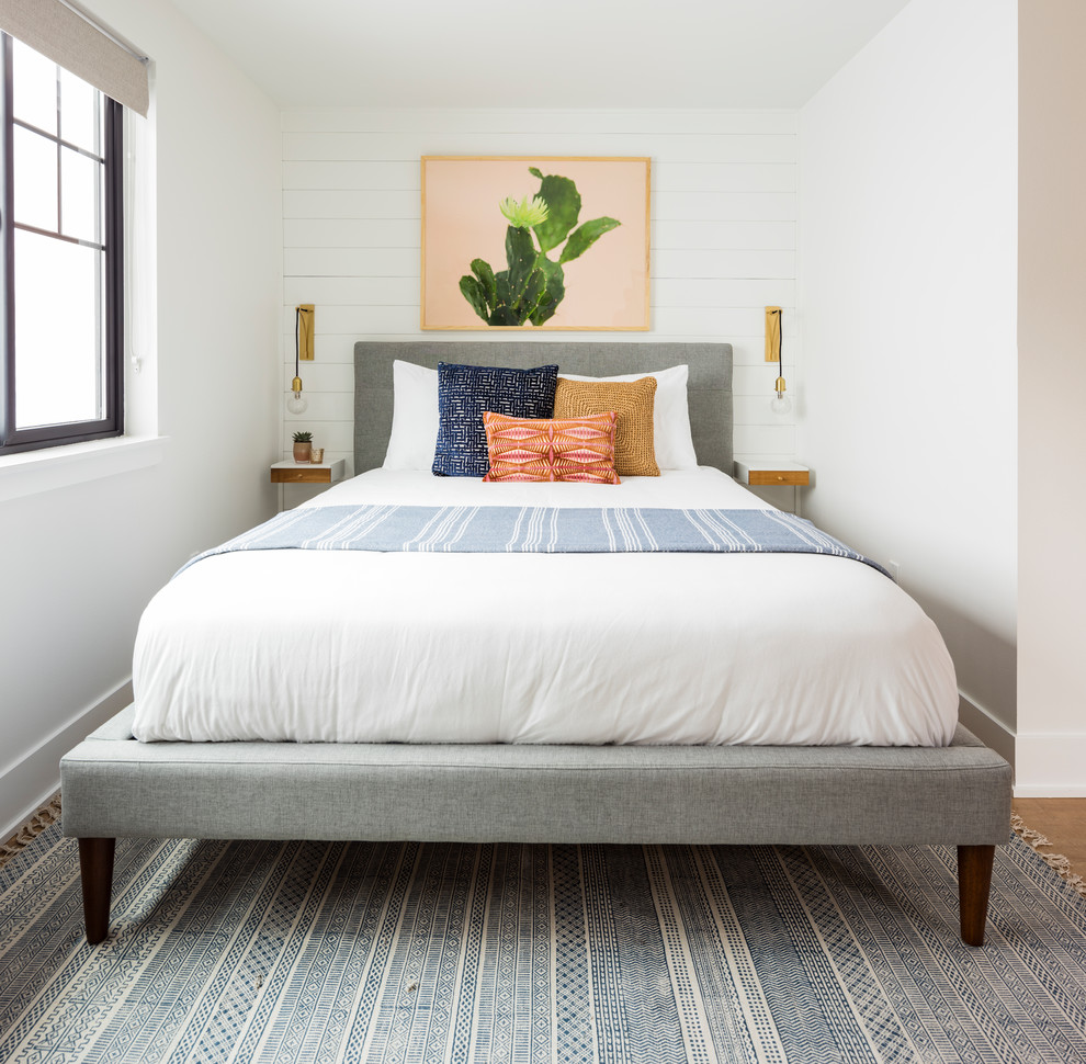 Bedroom - small scandinavian guest laminate floor and brown floor bedroom idea in Seattle with white walls and no fireplace