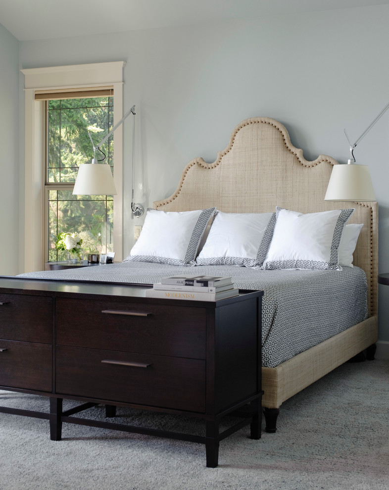 Example of a transitional master carpeted bedroom design in Seattle with blue walls