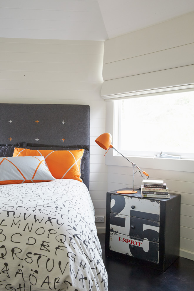 Example of a mid-sized urban master carpeted bedroom design in Sydney with white walls