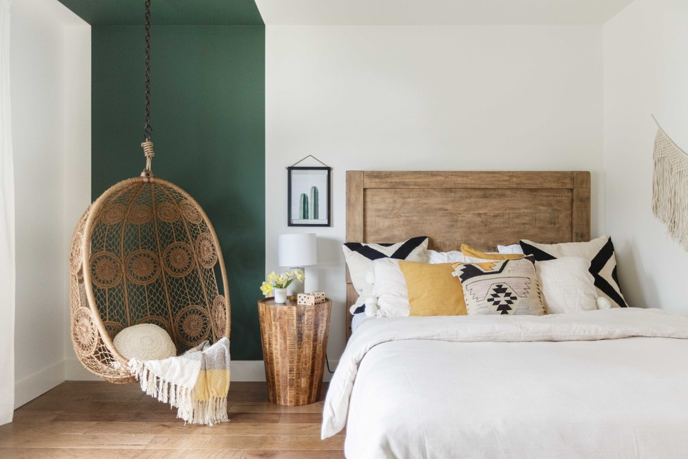 Inspiration for an eclectic light wood floor and beige floor bedroom remodel in Vancouver with multicolored walls