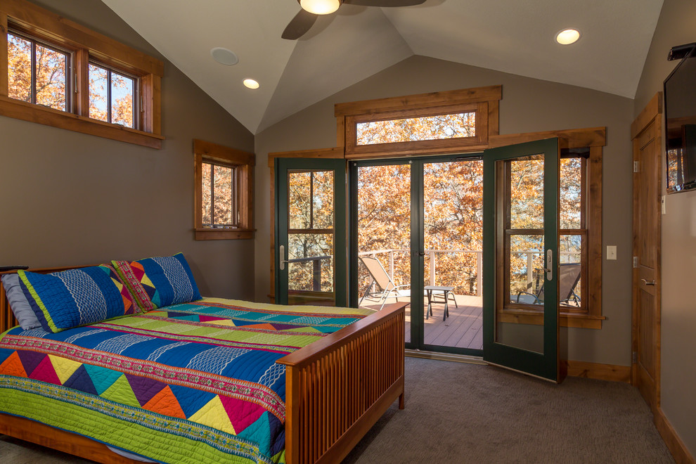 Example of a mid-sized mountain style master carpeted bedroom design in Minneapolis with gray walls and no fireplace