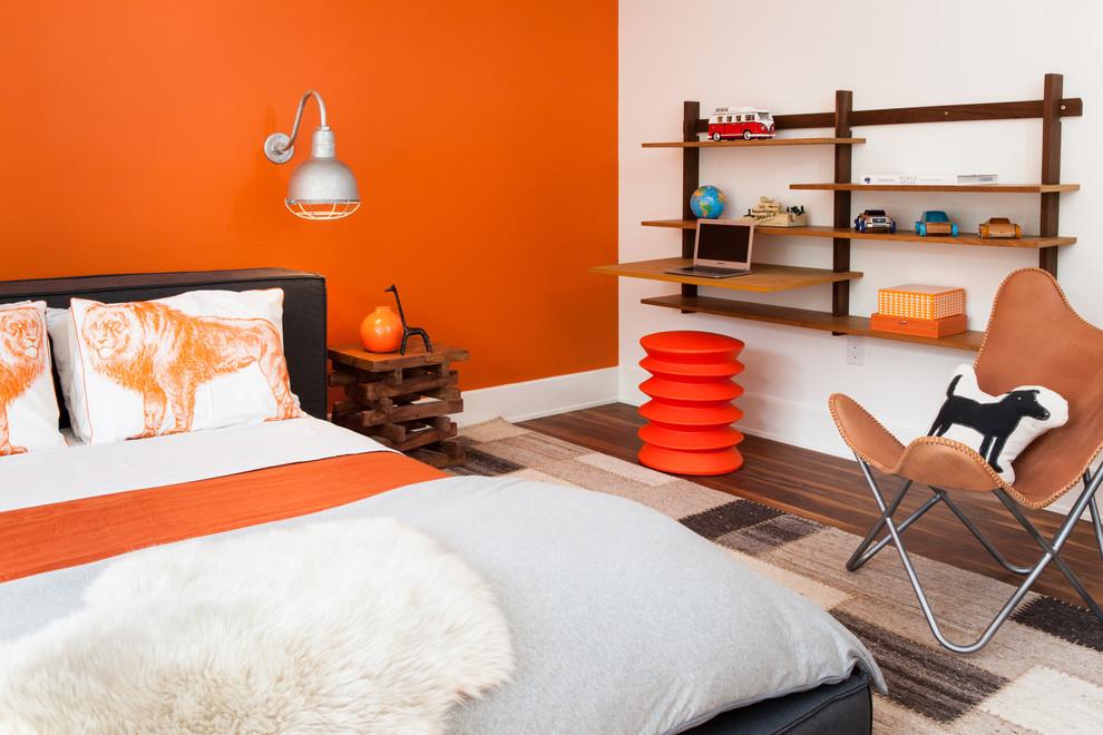 Example of a mid-sized trendy medium tone wood floor bedroom design in Boston with orange walls