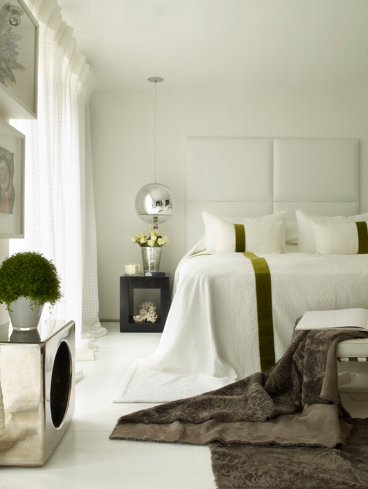 Example of a trendy white floor bedroom design in London with white walls