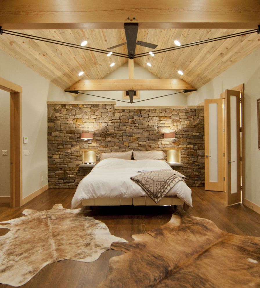 Bedroom - contemporary medium tone wood floor bedroom idea in Denver with beige walls