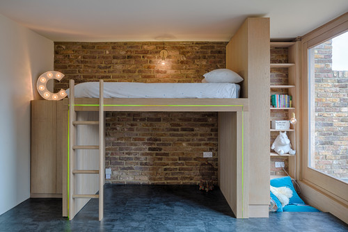 A high rising bed in a childrens bedroom