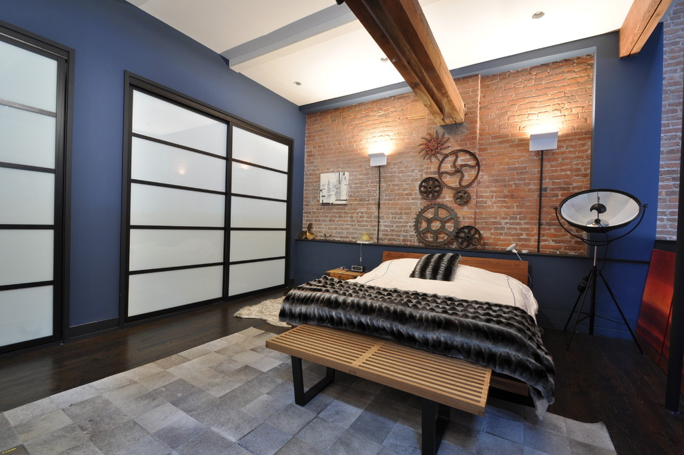 Mid-sized urban loft-style dark wood floor and brown floor bedroom photo in New York with blue walls and no fireplace