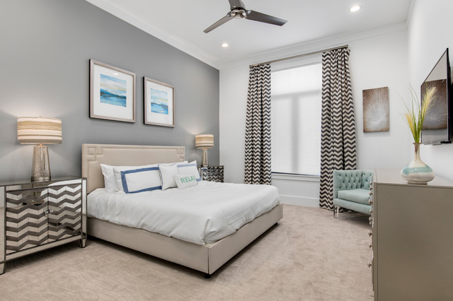 Example of a large minimalist guest carpeted bedroom design in Orlando with gray walls and no fireplace